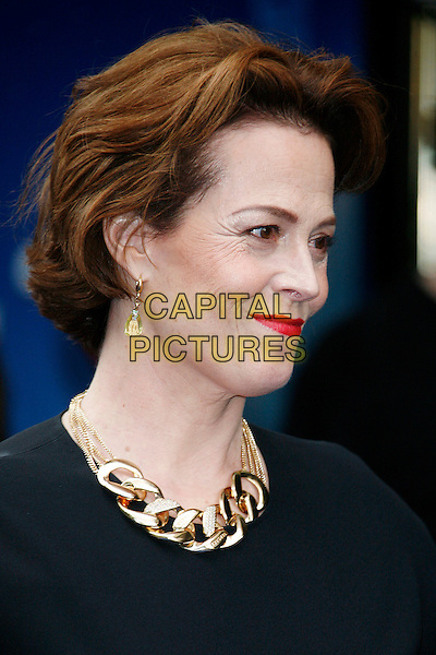 "SIGOURNEY WEAVER .Attending the UK Film Premiere of Disney Pixar's ""Wall-e"" at Empire Cinema Leicester Square, London, England, UK, July 13th 2008..WallE Wall*e Wall.E portrait headshot gold necklace chunky chain red lipstick  earrings black profile .CAP/DAR.©Darwin/Capital Pictures"