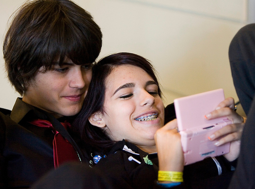 Photo by Stephen Brashear.Kyle Smith, left, of Sammamish, Wash., watches girlfriend Amber Cuozzo of Sammamish play Cake Mania on the Nintendo DS during the final day of the  Penny Arcade Exposition at the Washington State Visitor and Convention Center in Seattle, Wash., Sunday Aug. 31, 2008.