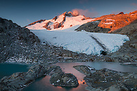 Sun setting over Mt. Brewster 2515m, Brewster Glacier and its terminal lake in spring, Mt. Aspiring National Park, UNESCO World Heritage Area, New Zealand