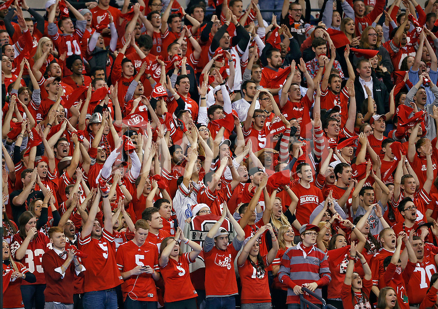 Ohio State Buckeyes student section cheer on a kickoff against Wisconsin Badgers during the 2nd quarter in the 2014 Big Ten Football Championship Game at Lucas Oil Stadium in Indianapolis, Ind. on December 6, 2014.  (Dispatch photo by Kyle Robertson)