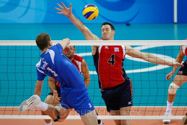 Serbia's Novica Bjelica spikes the ball past USA's David Lee, #4, during the quarterfinals match at the Capital Gymnasium in Beijing, Wednesday, August 20, 2008. USA defeated Serbia 3-2...Chris Detrick/The Salt Lake Tribune.