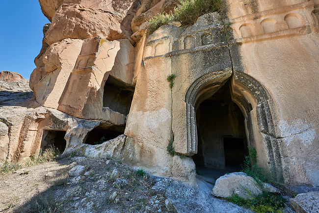 """Pictures & images of Kalburlu (St. Epthemios) church, 9th century, the Vadisi Monastery Valley, """"Manastır Vadisi"""",  of the Ihlara Valley, Guzelyurt , Aksaray Province, Turkey.<br /> <br /> Kalburlu (St. Epthemios) church dates back to the 9th or 10th century. It is carved out of a single rock massive with rock columns holding up the roof of its church . The arches of Kalburlu (St. Epthemios) church have rich architectural decorated relif sculptures. The naves are connected by rounded arches & there is a baptismal font to the east of the main entrance."""