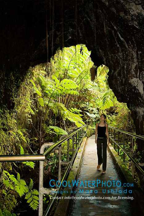 Woman visitor entering Thurston Lava Tube ( Nahuku ), Hawaii Volcanoes National Park, Kilauea, Big Island, Hawaii