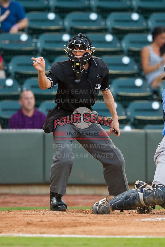 Home plate umpire Mike Patterson makes a strike call during the Carolina League game between the Wilmington Blue Rocks and the Winston-Salem Dash at BB&T Ballpark on August 3, 2013 in Winston-Salem, North Carolina.  The Blue Rocks defeated the Dash 4-2.  (Brian Westerholt/Four Seam Images)