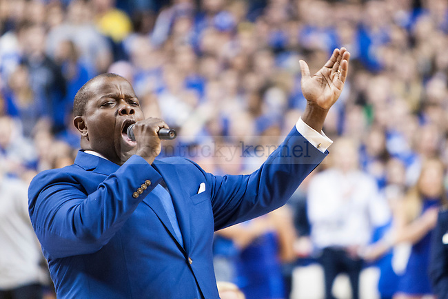 UK Director of Opera Everett McCorvey leads the fans in the singing of the National Anthem during the game against the Florida Gators at Rupp Arena on Saturday, March 7, 2015 in Lexington, Ky. Kentucky leads Florida 30-27 at the half. Photo by Michael Reaves | Staff.