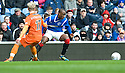 RANGERS' SONE ALUKO TRIES TO GET AWAY FROM DUNDEE UTD'S GARY MACKAY STEVENS