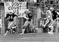 Oakland Raiders Burgess Owens runs back an interception with blocker John  Matuszak. against the Chicago Bears. (1981 photo/Ron Riesterer)