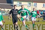 Castleisland's John McGaley control bemuses Paudie Dwyer Kilmallock and Mike McCarthy Castleisland
