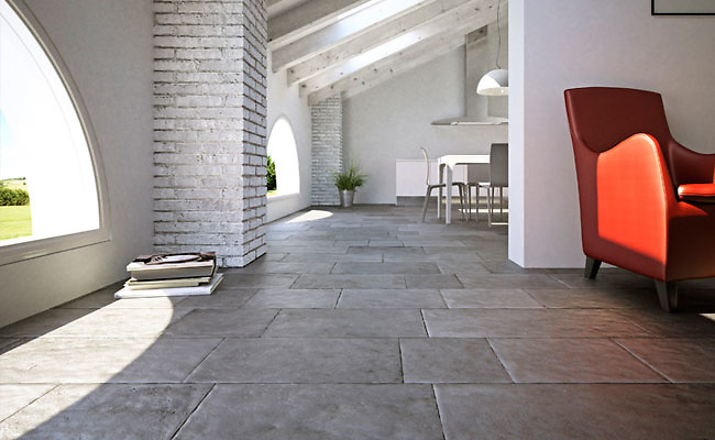 Solid Limestone Tiles with hand-cut edge, partially bush hammered surface and consumed natural undulated, time worn finish. Available in a very homogeneous Grey and a highly variegated Beige.<br />