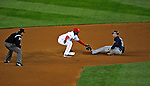 30 March 2008: Washington Nationals' infielder Cristian Guzman gets Atlanta Braves catcher Brian McCann out in an attempted steal at Nationals Park where the Washington Nationals defeated the visiting Atlanta Braves 3-2 in Washington, DC. The win for the Nationals christened the new state-of-the-art ballpark with a sellout crowd of 39,389...Mandatory Photo Credit: Ed Wolfstein Photo