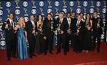 LOS ANGELES, CA. - September 20: Producer Jerry Bruckheimer (center) and the crew of 'The Amazing Race pose in the press room at the 61st Primetime Emmy Awards held at the Nokia Theatre on September 20, 2009 in Los Angeles, California.