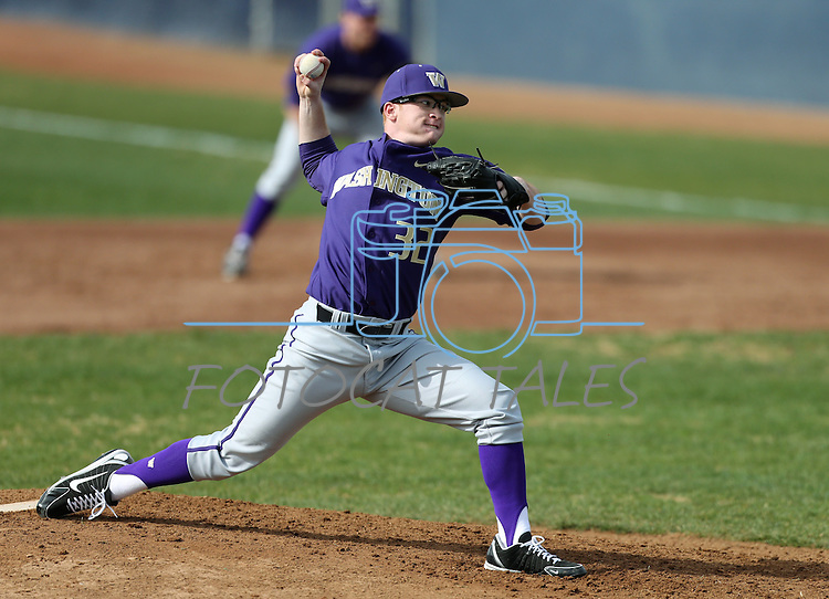 University of Washington's Tyler Davis pitches against UC Davis in a college baseball game in Davis, Ca., on Saturday, Feb. 16, 2013. Davis won the opener 6-5 and dropped the second game 3-2..Photo by Cathleen Allison