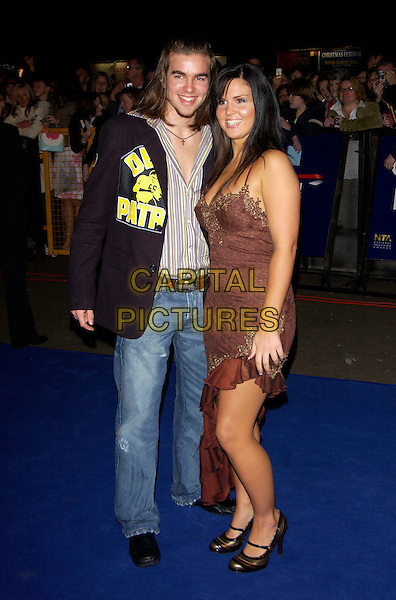 STUART WILSON & MICHELLE BASS (BIG BROTHER 5 ).10th Anniversary National Television Awards. Royal Albert Hall, London, October 26th 2004..full length couple brown dress.Ref: PL.www.capitalpictures.com.sales@capitalpictures.com.©Capital Pictures.