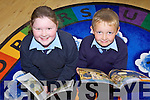 BOOKED: At the opening of the new library at St Oliver's NS in Ballylongford on Friday were Molly O'Neill and Brian Murphy..