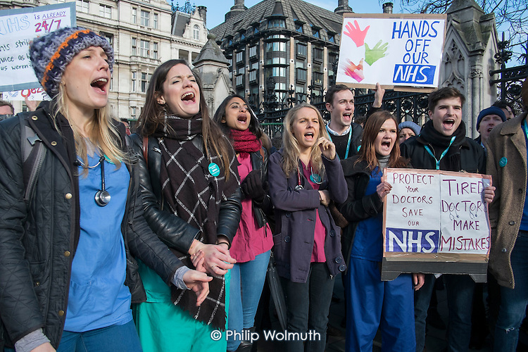 Junior doctors from London St Thomas's and Guy's hospitals on strike over a proposed new contract march across Westminster Bridge to protest outside the Houses of Parliament.