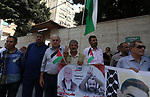Palestinians take part in a protest to show solidarity with Palestinian prisoners held in Israeli jails, in front of Red cross office in Gaza city on July 24, 2017. Photo by Mohammed Asad