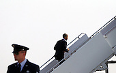 United States President Barack Obama boards Air Force One prior to a campaign trip July 5, 2012 at Joint Base Andrews in Maryland. Obama was going on a on a two-day campaign bus tour through northern Ohio.  .Credit: Alex Wong / Pool via CNP