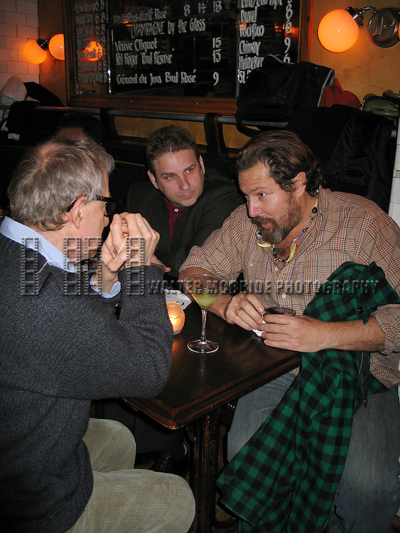 Woody Allen chatting with Artist Julian Schnabel, John Johnson and chef Richard Pedrina.Attending the new Woody Allen movie Premiere Reception Party for MELINDA AND MELINDA at Pastis Restaurant in New York City..March 16, 2005.© Walter McBride /