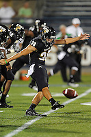 1 September 2011:  FIU kicker Jack Griffin (38) kicks after a safety late in the fourth quarter as the FIU Golden Panthers defeated the University of North Texas, 41-16, at University Park Stadium in Miami, Florida.