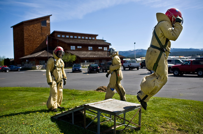 The McCall smokejumper crew practices a ramp exercise, jumping off the low ramp and twisting their bodies to better absorb the impact of a parachute landing.