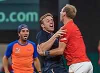 The Hague, The Netherlands, September 17, 2017,  Sportcampus , Davis Cup Netherlands - Chech Republic, Fifth match : Thiemo de Bakker (NED) is celebratiën with Tallon Griekspoor (M) and Jean-Julien Rojer (L)<br /> Photo: Tennisimages/Henk Koster