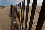 Close up of wooden fence on beach in USA