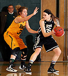 JANUARY 23, 2015 -- Brittany Hernandez #35 of UC-Colorado Springs shields the ball from Cassidy Kotelman #30 of Black Hills State during their Rocky Mountain Athletic Conference women's basketball game Friday at the Donald E. Young Center in Spearfish, S.D. (Photo by Dick Carlson/Inertia)