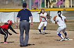 Western Nevada's shortstop Jennifer Rechel makes the throw to Madison Gonzalez to get an out during a college softball game against Colorado Northwestern Community College in Carson City, Nev., on Friday, Feb. 22, 2013..Photo by Cathleen Allison/Nevada Photo Source