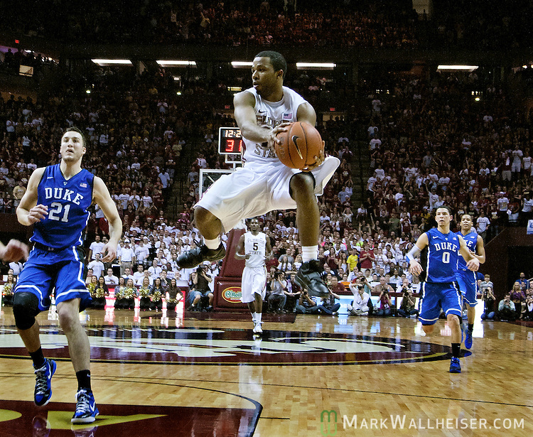 FSU's Jeff Peterson (12) makes a pass under the basket when the15th ranked Florida State Seminoles fell 74-66 to the 4th ranked Duke Blue Devils in an NCAA basketball game in Tallahassee, Florida November 23, 2010.