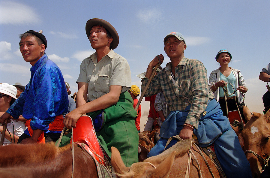 Khui Doloon Khudag, Mongolia, July 2003..Competitors & spectators at the horse racing in the national Naadam 40 kilometres outside Ulaanbaatar.