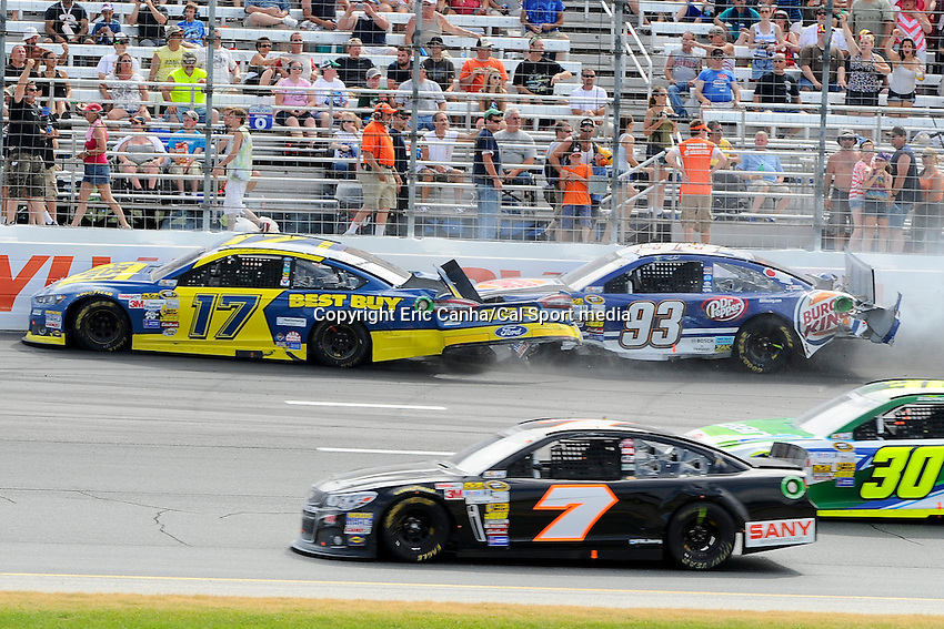 July 14, 2013 - Loudon, New Hampshire U.S. - Sprint Cup Series driver Ricky Stenhouse Jr. (17) and Travis Kvapil (93) crash in turn 1 during in the NASCAR Sprint Cup Series Camping World RV Sales 301 held at the New Hampshire Motor Speedway in Loudon, New Hampshire.   Eric Canha/CSM