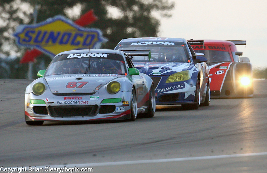 The #87 Porsche of Leh Keen and Dirk Werner in action at the Crown Royal 200 Grand-Am Rolex Series race at Watkins Glen International Raceway, Watkins Glen, NY, August 2009. (Photo by Brian Cleary/www.bcpix.com)