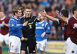 Steven Davis has a word in Callum Murray's ear as Dorin Goian earns a yellow card for fouling David Templeton