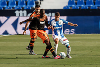 12th July 2020; Estadio Municipal de Butarque, Madrid, Spain; La Liga Football, Club Deportivo Leganes versus Valencia; Geoffrey Kondogbia (Valencia CF) plays the ball under pressure from Rosales of Leganes