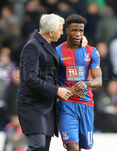 21.02.2016. White Hart Lane, London, England. Emirates FA Cup 5th Round. Tottenham Hotspur versus Crystal Palace. Alan Pardew and Wilfried Zaha discuss tactics