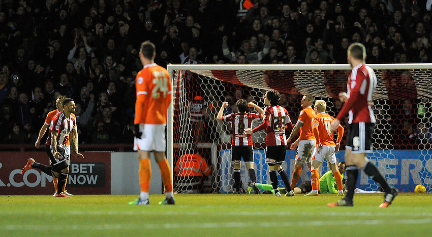 Brentford's Andre Gray scores his sides third goal <br /> <br /> Photographer Ashley Western/CameraSport<br /> <br /> Football - The Football League Sky Bet League One - Brentford v Blackpool - Tuesday 24th February 2015 - Griffin Park - London<br /> <br /> &copy; CameraSport - 43 Linden Ave. Countesthorpe. Leicester. England. LE8 5PG - Tel: +44 (0) 116 277 4147 - admin@camerasport.com - www.camerasport.com