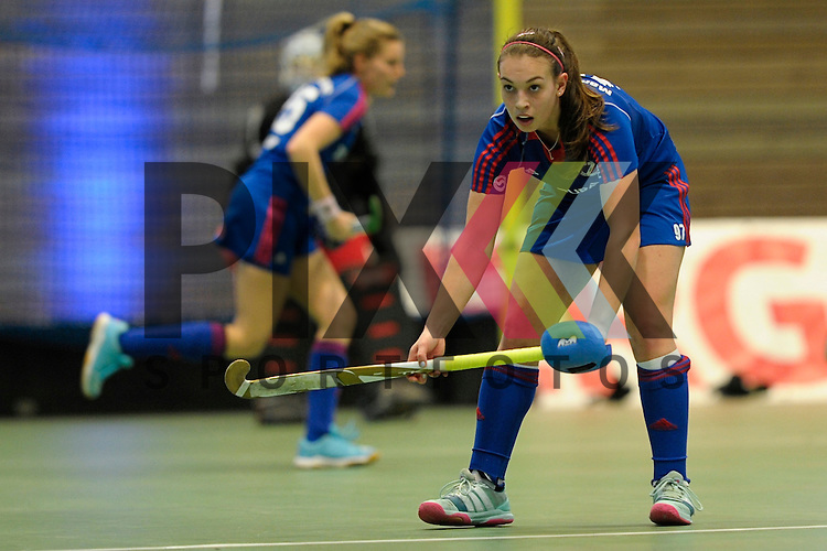 GER - Luebeck, Germany, February 07: During the 1. Bundesliga Damen indoor hockey final match at the Final 4 between Mannheimer HC (blue) and Duesseldorfer HC (white) on February 7, 2016 at Hansehalle Luebeck in Luebeck, Germany.   Julia Meffert #97 of Mannheimer HC