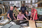 Gate Darkroom members visit the North Paddington Community Darkroom archive at the Bishopsgate Institute, London.