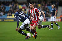 Sergi Canos of Brentford takes on the Millwall defence during Millwall vs Brentford, Sky Bet EFL Championship Football at The Den on 10th March 2018