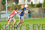 Mike Francis Russell Laune Rangers gets his pass away despite Colm Kelly Rathmore best efforts during their division 1 clash in Killorglin on Saturday