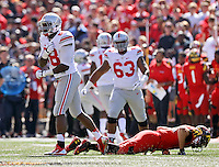 Ohio State Buckeyes defensive lineman Steve Miller (88) celebrates tackling Maryland Terrapins quarterback C.J. Brown (16) during the first quarter of the NCAA football game at Byrd Stadium in College Park, Maryland on Oct. 4, 2014. (Adam Cairns / The Columbus Dispatch)