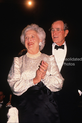 United States President-elect George H.W. Bush and his wife, Barbara Bush attend a dinner at the Corcoran Gallery of Art in Washington, D.C. on January 18, 1989.<br /> Credit: Brad Markel / Pool via CNP