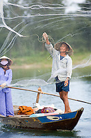 A fisherman casts his net on the Thu Bon River near Hoi An VI.