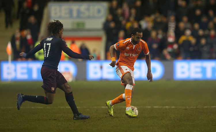 Blackpool's Nathan Delfouneso and Arsenal's Alex Iwobi<br /> <br /> Photographer Stephen White/CameraSport<br /> <br /> Emirates FA Cup Third Round - Blackpool v Arsenal - Saturday 5th January 2019 - Bloomfield Road - Blackpool<br />  <br /> World Copyright &copy; 2019 CameraSport. All rights reserved. 43 Linden Ave. Countesthorpe. Leicester. England. LE8 5PG - Tel: +44 (0) 116 277 4147 - admin@camerasport.com - www.camerasport.com