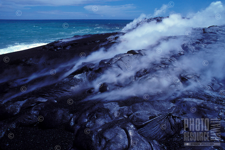 New lava flow covering the black sand beach, Puna
