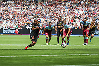 GOAL - Sergio Aguero of Manchester City scores from the penalty spot to make the score 0-4 during the Premier League match between West Ham United and Manchester City at the London Stadium, London, England on 10 August 2019. Photo by David Horn.