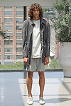 Model Griffin poses in an outfit from the Deveaux Spring Summer 2017 collection on July 13 2016, during New York Fashion Week Men's Spring Summer 2017.