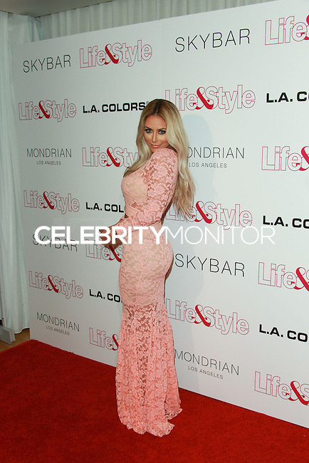 WEST HOLLYWOOD, CA, USA - OCTOBER 23: Aubrey O'Day arrives at the Life & Style Weekly 10 Year Anniversary Party held at SkyBar at the Mondrian Los Angeles on October 23, 2014 in West Hollywood, California, United States. (Photo by David Acosta/Celebrity Monitor)