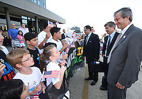 Harold Mayne-Nicholls (center) head of delegation meets young greeters during the arrival of the FIFA World Cup 2018-2022 inspection delegation to Washington D.C. at Dulles International Airport.