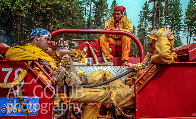 August 20, 1992 Angels Camp, California -- Old Gulch Fire—CDF firefighters rest on back of truck on Sheep Ranch Road.  The Old Gulch Fire raged over some 18,000 acres, destroying 42 homes while threatening the Mother Lode communities of Murphys, Sheep Ranch, Avery and Forest Meadows.